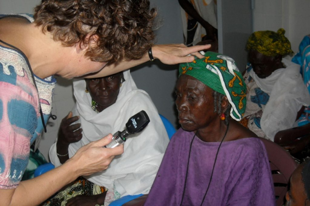 peace corps volunteers and Dr Judith Simon with patients